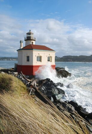 Coquille River Lighthouse built in 1896, is a 47 foot tower guided boats up the mouth of the Coquille River, in Bandon Oregon Stock Photo - 14922739