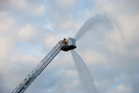 Inservice training on a new 100 foot platform fire truck   Working with ladder placement and elevated master streams  photo