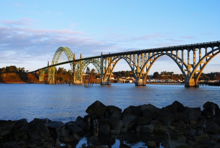Yaquina Bay Bridge and Yaquina Bay, a steel arch bridge is a McCullough engineered masterpiece of the Pacific Coast Hwy System in Newport Oregon Stock Photo