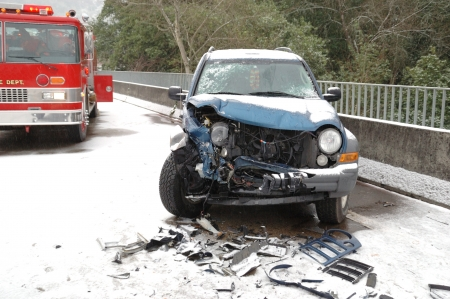 Head on Collision Results on a SUV  Ice storm accident on the Stewart Parkway Bridge, 2 persons transported,  Roseburg Oregon Stock Photo - 15625727