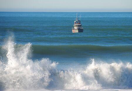 guard ship: US Coast Guard Life Boat working the entrance to the Rogue River Bay near Gold Beach Oregon