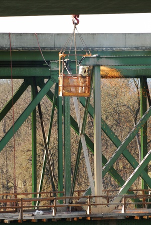 Workers removing the old Northbound Structure of the Shady Bridge   Worker is cutting out the old metal substructure  photo