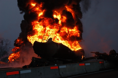 Truck carrying 10,000 gals of fuel wrecked into construction divider Stock Photo - 16516665
