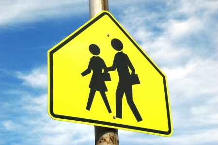 School Crossing Sign and Sky   crosswalk leading up to an elementary school