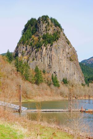 Beacon Rock, a 800 ft sheer-walled plug of an ancient volcano on the Washington side of the Columbia River Gorge Scenic Area  photo