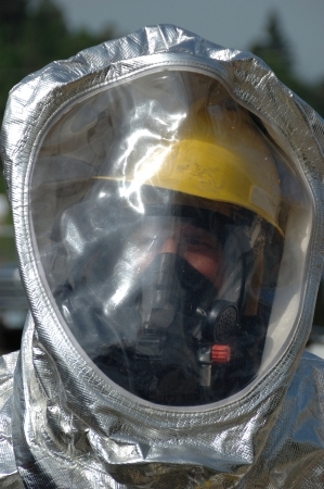 Flash Protected A-Level Suit  Putting the A-Kit on a 150 bottle, Haz Mat Drill at Roseburg OR City Public Works Shop Stock Photo - 17713904