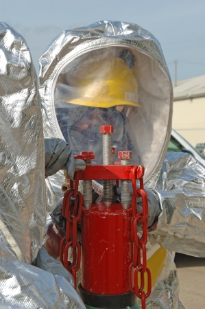 hazardous material team:  Putting the A-Kit onto a Leaking High Pressure Bottle  Putting the A-Kit on a 150 bottle, Haz Mat Drill at Roseburg OR City Public Works Shop