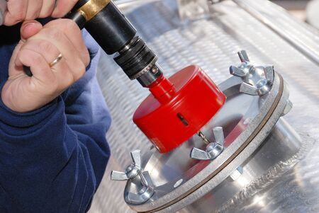 Cold drilling or tap through the side of a flammable liquid tank truck trailer to transfer product following a roll over