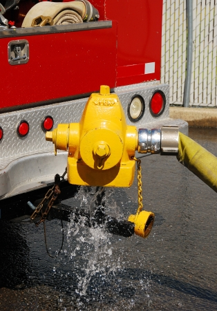 public works: Testing fire hydrants using a new hydrant diffuser that was made by Roseburg City Public Works for the fire dept   It uses the top of a old waterous hydrant top that is welded to a trailer hitch stinger