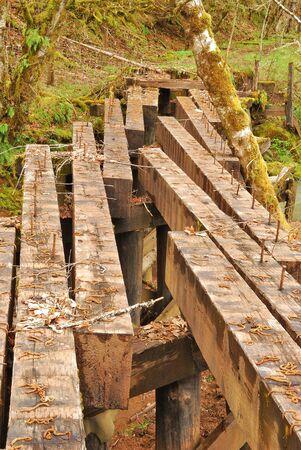 logging railway: Old logging railroad bridge crossing Gassy Creek East of Sutherlin Oregon off of Nonpareil Road at Gassy Creek Road  Stock Photo