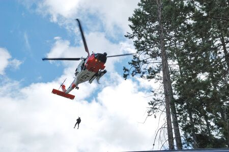 excersise: US 102nd Civil Support Team in training excersise utilizing a US Coast Guard Helicopter, Sunriver Oregon, May 7, 2007 Editorial