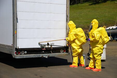 incident: Fire fighters making entry on a truck leaking fluid,  The hazardous materials team trains on a recent corrosive drill in Roseburg Oregon  May 28, 2009