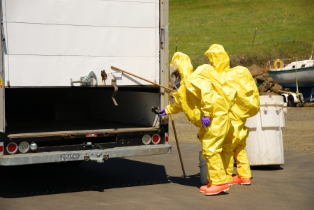 Fire fighters making entry on a truck leaking fluid,  The hazardous materials team trains on a recent corrosive drill in Roseburg Oregon  May 28, 2009 Stock Photo - 19075420