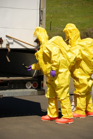 wmd: Fire fighters making entry on a truck leaking fluid,  The hazardous materials team trains on a recent corrosive drill in Roseburg Oregon  May 28, 2009