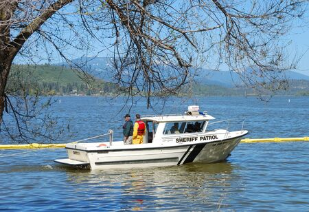 haz: Klamath County Sheriff Marine Boat druing a Booming drill on Klamath Lake for the Oregon State Haz Mat outreach video in Klamath Falls Oregon