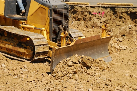 Small bulldozer working on the site of new business building project in Roseburg Oregon
