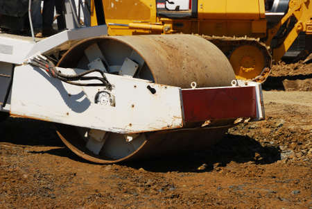 compacting: Compacting the soil during site prep with a vibration roller on a new business  project in Roseburg Oregon