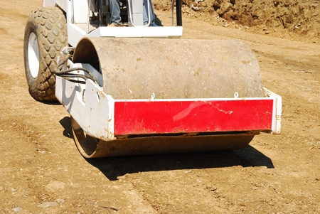 Compacting the soil during site prep with a vibration roller on a new business  project in Roseburg Oregon Stock Photo - 19838431