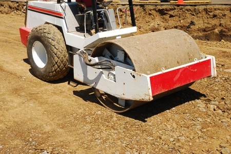 construction vibroroller: Compacting the soil during site prep with a vibration roller on a new business  project in Roseburg Oregon