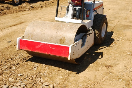 Compacting the soil during site prep with a vibration roller on a new business  project in Roseburg Oregon Stock Photo - 19838484