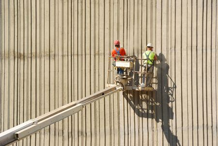 worksite: Workers cleaning up the lines on the side of a new bridge support pillar   Interstate 5 near Roseburg Oregon Stock Photo