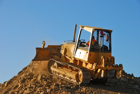 Small bulldozer building a spoils pile at a new business construction project in Roseburg Oregon