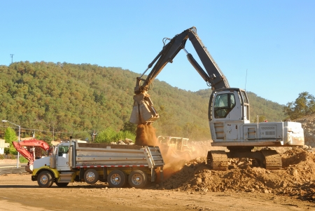 Loading a dumptuck at a new business consturction project in Roseburg Oregon photo