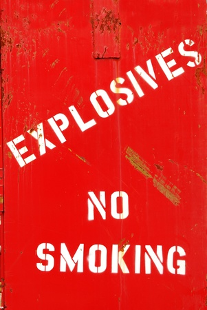 Explosives, No Smoking painted on a bunker at a city shop building photo