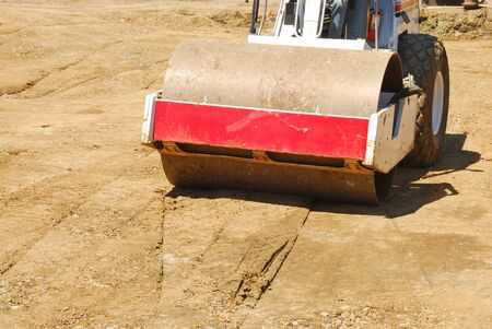 vibroroller: Compacting the soil during site prep with a vibration roller on a new business  project in Roseburg Oregon