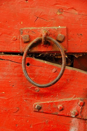 hitching post: Horse stall bar tie on a red wall hitching post in an agricultural barn Stock Photo