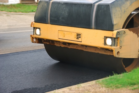 roller compactor: Large vibrating roller compactor working on an asphalt repaving project in Roseburg Oregon Stock Photo
