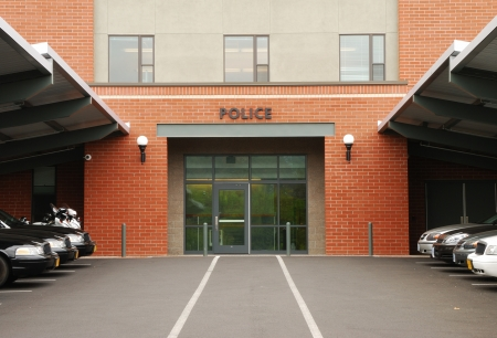 enforce: Police cruisers parked outside of a main police station in Roseburg Oregon Stock Photo