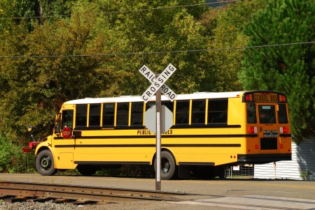 A school bus stopped at a uncontrolled railroad crossing in Roseburg Oregon photo