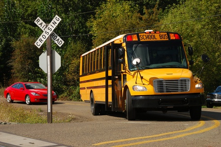 uncontrolled: A school bus stopped at a uncontrolled railroad crossing in Roseburg Oregon