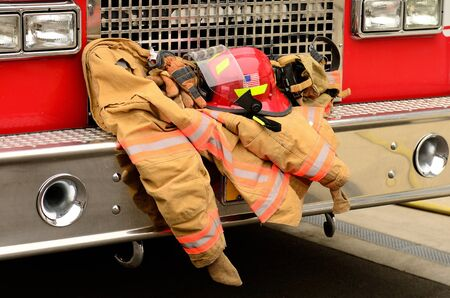 turnout gear: Fire fighters participating in a  traped person training excercise