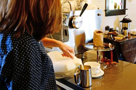 A barista prepares a espresso coffee drink at a quaint shop in a large northwest city photo