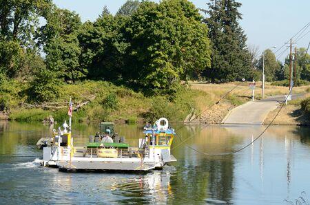 willamette: A ferry crosses the Willamette River in Oregon outside Salem Editorial