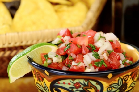 spicy: Salsa and guacamole with chips table top food shot Stock Photo