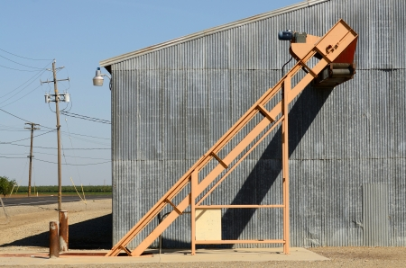 inground: Inground conveyer belt loading system sits outside a warehouse in the central California valley