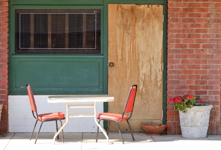 chairs and table sit outside a small county bar in central California agriculture country Stock Photo - 21024813