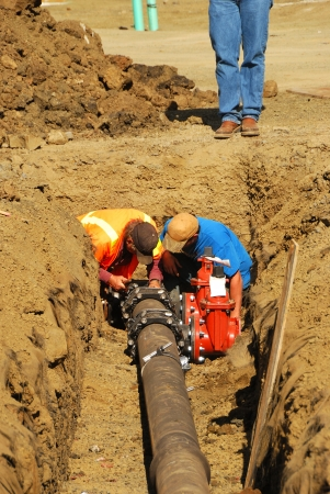 Installing a new water supply pipe on a new commercial building site in Roseburg Oregon