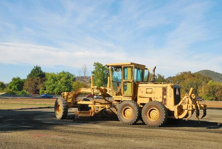 Land Grader working the building pad of a new tennis court in Roseburg Oregon at Stewart Park Stock Photo - 21026082