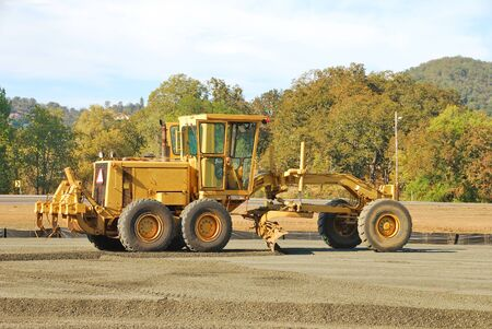 Land Grader working the building pad of a new tennis court in Roseburg Oregon at Stewart Park Stock Photo - 21026084