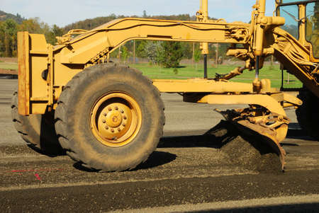 Land Grader working the building pad of a new tennis court in Roseburg Oregon at Stewart Park Stock Photo - 21164276