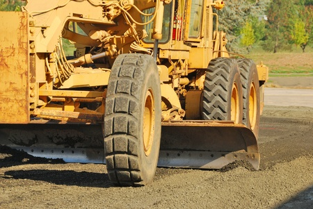Land Grader working the building pad of a new tennis court in Roseburg Oregon at Stewart Park Stock Photo - 21164277