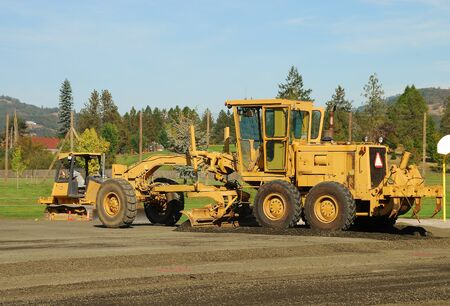 Land Grader working the building pad of a new tennis court in Roseburg Oregon at Stewart Park Stock Photo - 21164278