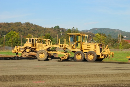 Land Grader working the building pad of a new tennis court in Roseburg Oregon at Stewart Park photo