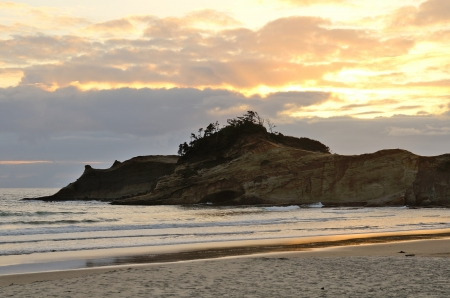 Unique sand spit (Bob Straub Park)  in the sunset light at Pacific City Oregon with mild Pacific ocean surf photo