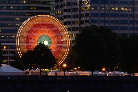 eastbank: A colorful ferris wheel lights up against the city skyline of Portland Oregon during the Rose Festival CityFair