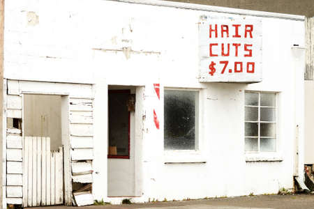 An old now closed barber shop in the Empire district, Coos Bay Oregon at har cuts seven dollars Stock Photo - 21293881